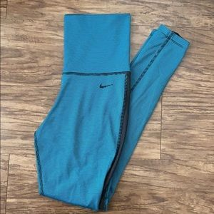 Nike teal and black striped leggings